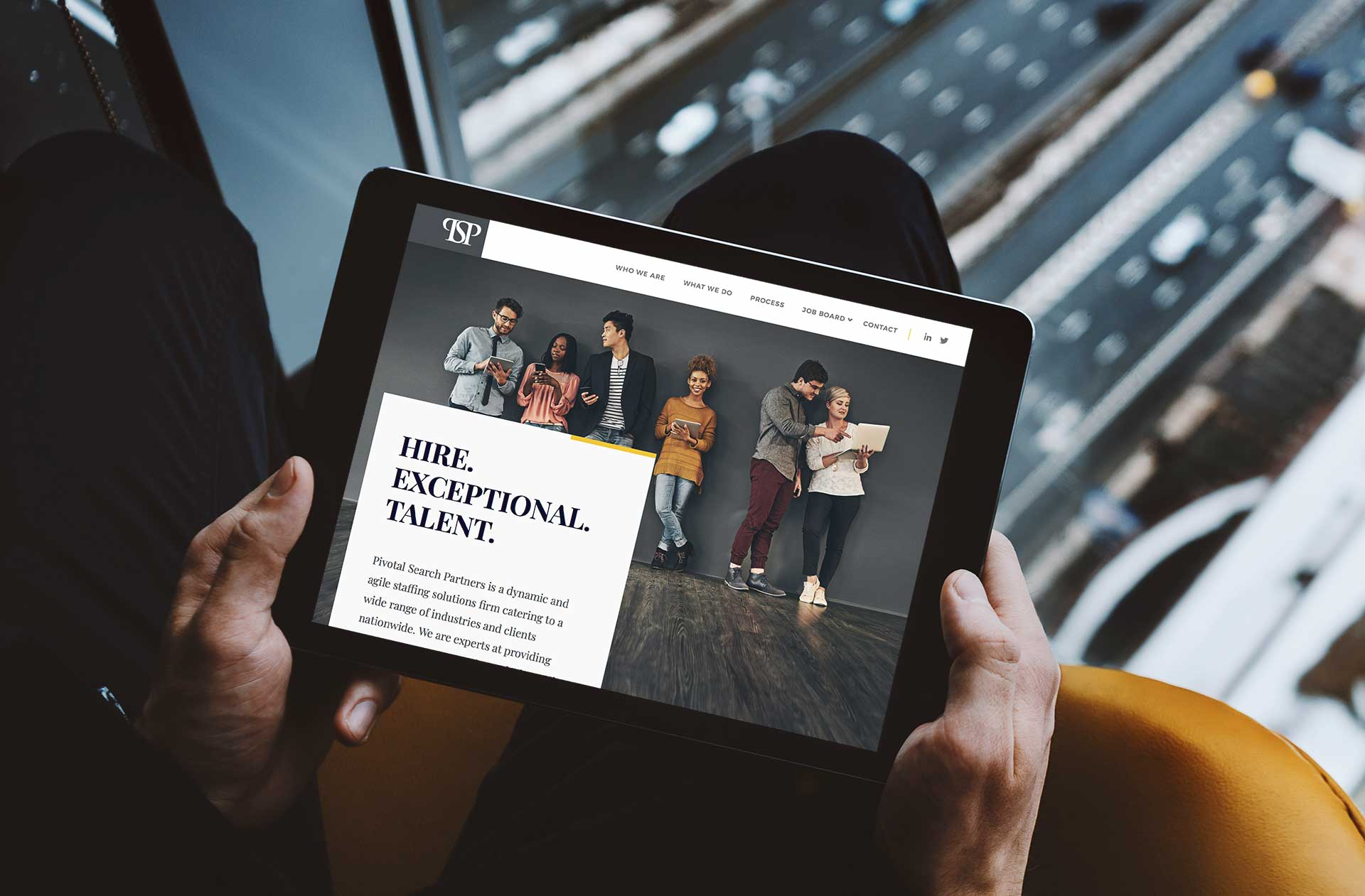 Man holding a tablet with a small business website design on it for a staffing company
