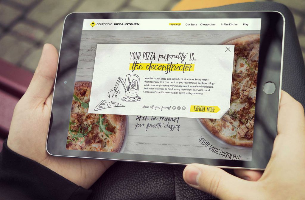California Pizza Kitchen mobile app promotional game design in a tablet held by a man