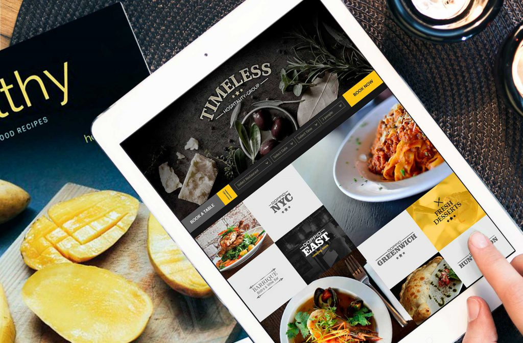 Italian restaurant website design in a tablet with pasta and italian food