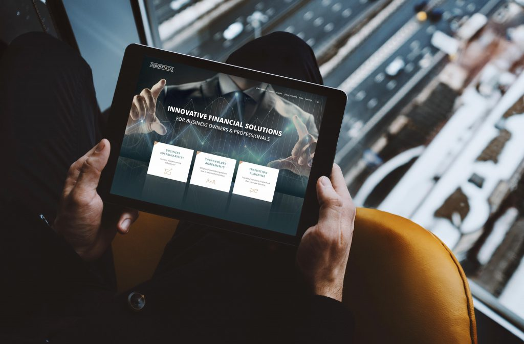 business man holding an small business website design in an ipad