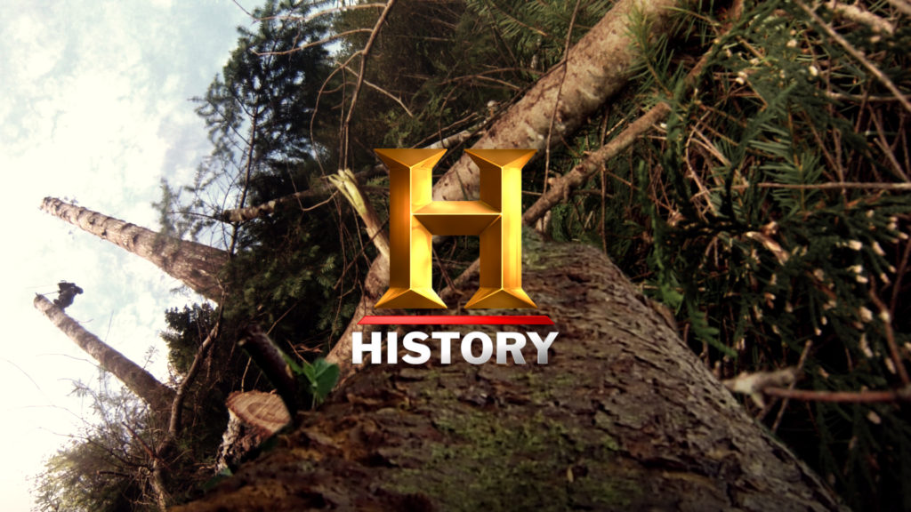 History Channel Branding for the History Ax Men program with a forest background and a gold history logo