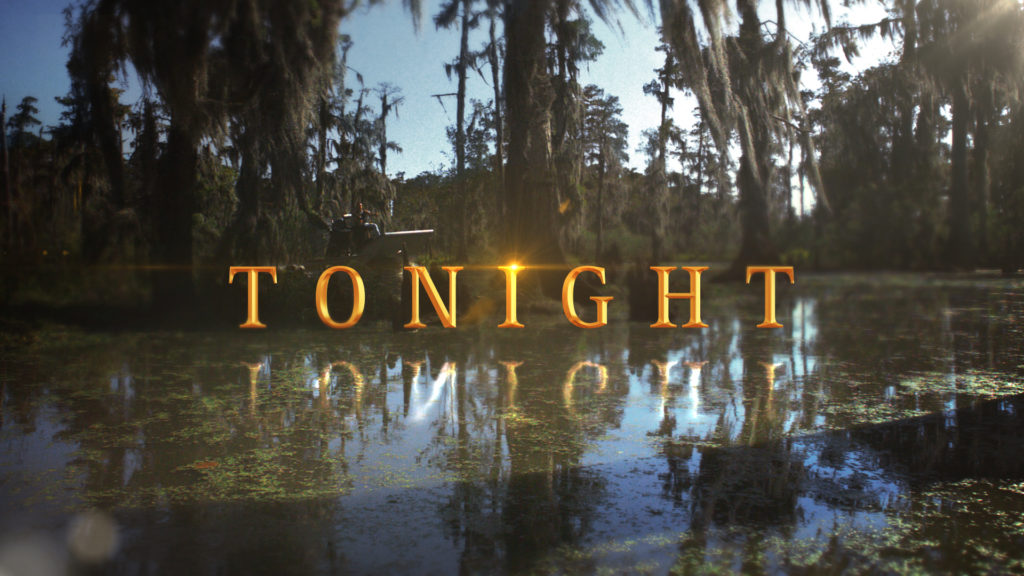 Swamp Men title card with the History gold chiseled font